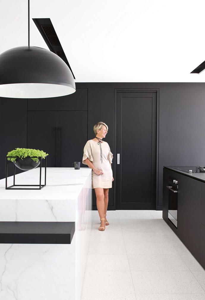 """""""It took about two years to really pin down what I wanted,"""" she says. """"And I'm glad I took my time because I think if I had built the house two years earlier, I wouldn't have been as happy with it as I am today.""""<br><br>**Kitchen** Black and white can be cosy! """"It's all about adding timber textures and playing with finishes,"""" says Sarah."""