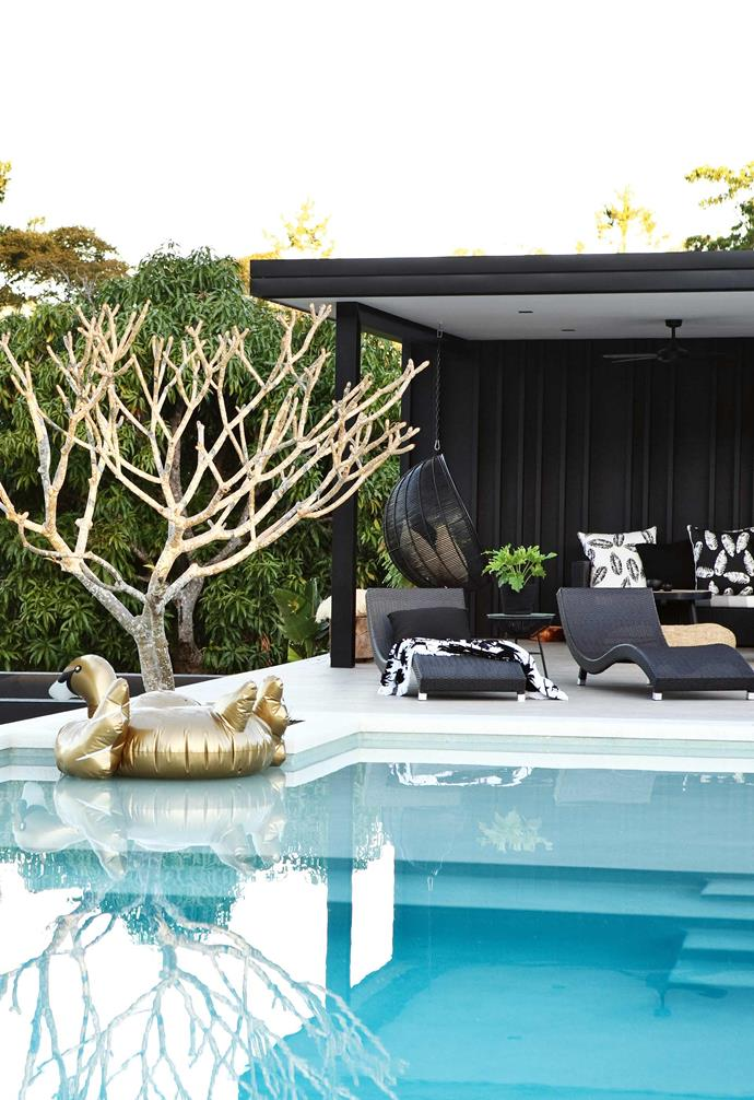 """Sarah was determined to be across every detail of the build to ensure she had complete control over the decisions. She decided the best way to remain informed was to obtain her own builder's licence.<br><br>**Pool** """"We added a beach-inspired shallow ledge to the pool, just for lazing in,"""" says Sarah. """"The pool adds to the holiday feel."""" The family can recline in sun-loungers from Harvey Norman and the HK Living hanging ball chair."""