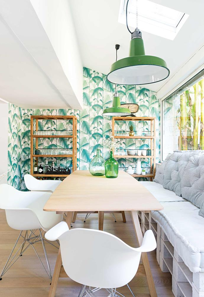 "Natacha and Charles love the [dining room's](https://www.homestolove.com.au/best-dining-room-ideas-18556|target=""_blank"") outlook onto the garden and its banana palms, so they decided to continue the [tropical feel indoors](https://www.homestolove.com.au/10-tropical-rooms-20582