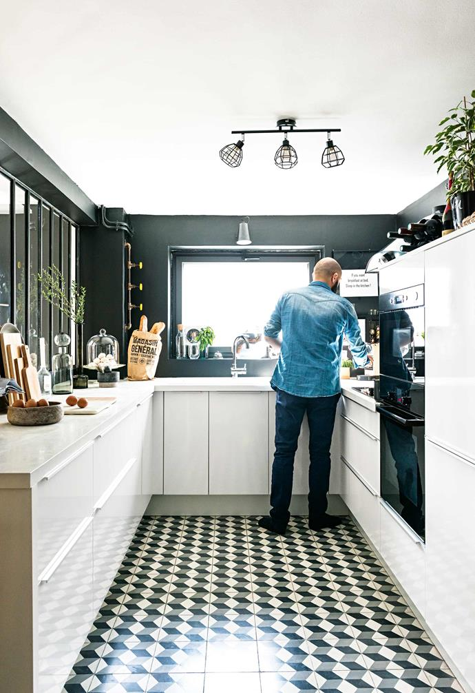 "Handmade cement floor tiles featuring a three-dimensional cube pattern are the hero of the kitchen, with its [smart scheme of crisp black and white](https://www.homestolove.com.au/black-and-white-kitchens-21138|target=""_blank""). ""I was slightly worried when Natacha asked me to [buy black paint](https://www.homestolove.com.au/best-dark-paint-colours-20169