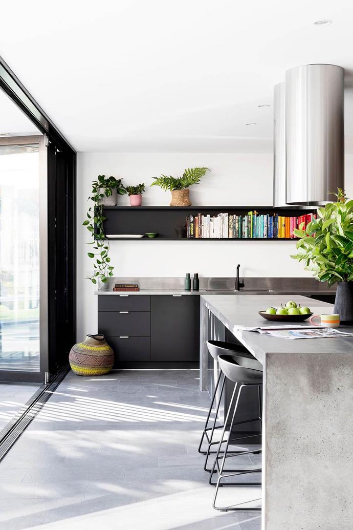 """A seamless concrete island in this [industrial-style kitchen](https://www.homestolove.com.au/energy-efficient-home-upgrades-5786