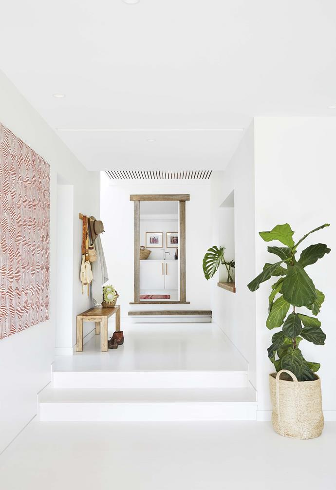 "The walls and floors in this [all-white Byron Bay home](https://www.homestolove.com.au/relaxed-all-white-byron-bay-home-with-upcycled-details-19266|target=""_blank"") were painted in Dulux Vivid White."