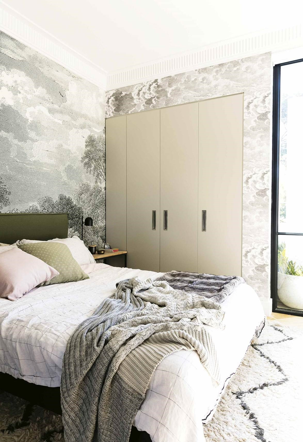Neutral and soft pastel tones create a soothing ambience in this dreamy bedroom.