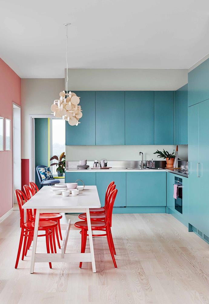 """**Kitchen** The wall shade is Nancy's Blushes by [Farrow & Ball](https://www.farrow-ball.com/). Sara had the Thonet chairs customised in her favourite red. The table is [Ikea](https://www.ikea.com/au/en/ Target=""""_blank"""" rel=""""nofollow""""), and on it are pieces by [Marimekko](https://www.marimekko.com/ Target=""""_blank"""" rel=""""nofollow""""), [Alessi](https://www.alessi.com/ Target=""""_blank"""" rel=""""nofollow"""") and Rörstrand, a Swedish porcelain maker. Bau Lamp by [Normann Copenhagen](https://www.normann-copenhagen.com/en/Product/Product-Collections Target=""""_blank"""" rel=""""nofollow"""")."""