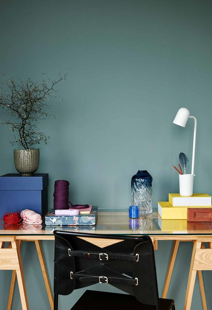 """**Studio** A chair by Normann Copenhagen pulls up to the Design House Stockholm desk. Buddy lamp, Northern. On the table are accessories from Hay. Wall colour, Stone Blue by  [Farrow & Ball](https://www.farrow-ball.com/ Target=""""_blank"""" rel=""""nofollow"""")."""