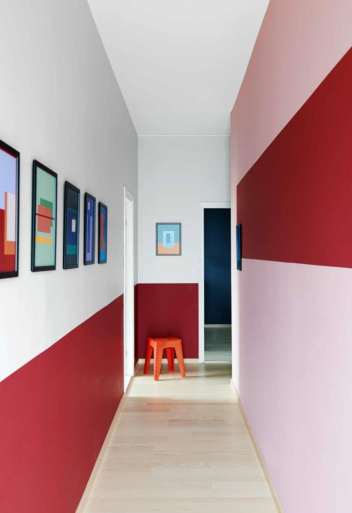 """**Hallway** Red Radicchio stripes by  [Farrow & Ball](https://www.farrow-ball.com/ Target=""""_blank"""" rel=""""nofollow"""") line the passage, along with 10 framed prints by Sara and Straight Design. Cord stool, Crooked Concept."""