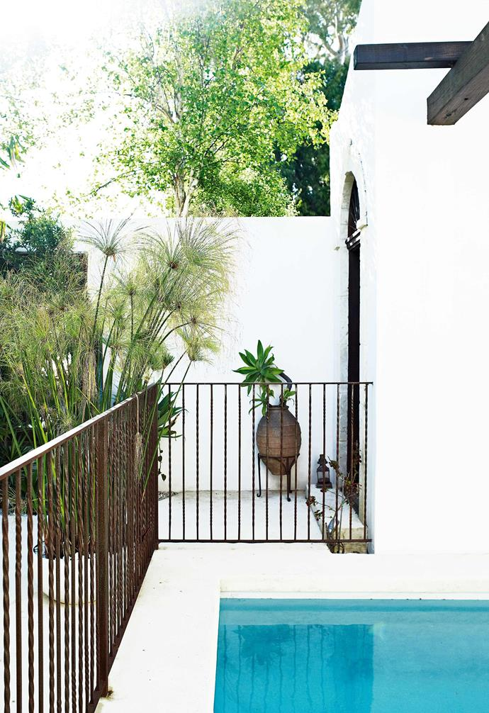 "With a limestone courtyard and a bathhouse-inspired pool, the home feels like the five-star resort on everyone's wish-list. But, of course, 'resort style' is Giovanni's thing – he is currently working on a collection of 18 villas in Phuket, Thailand.<br><br>**Pool** Giovanni used a mix of white paints to create a limewashed effect. ""With a neutral backdrop, you can try different things together and it still works,"" he says."