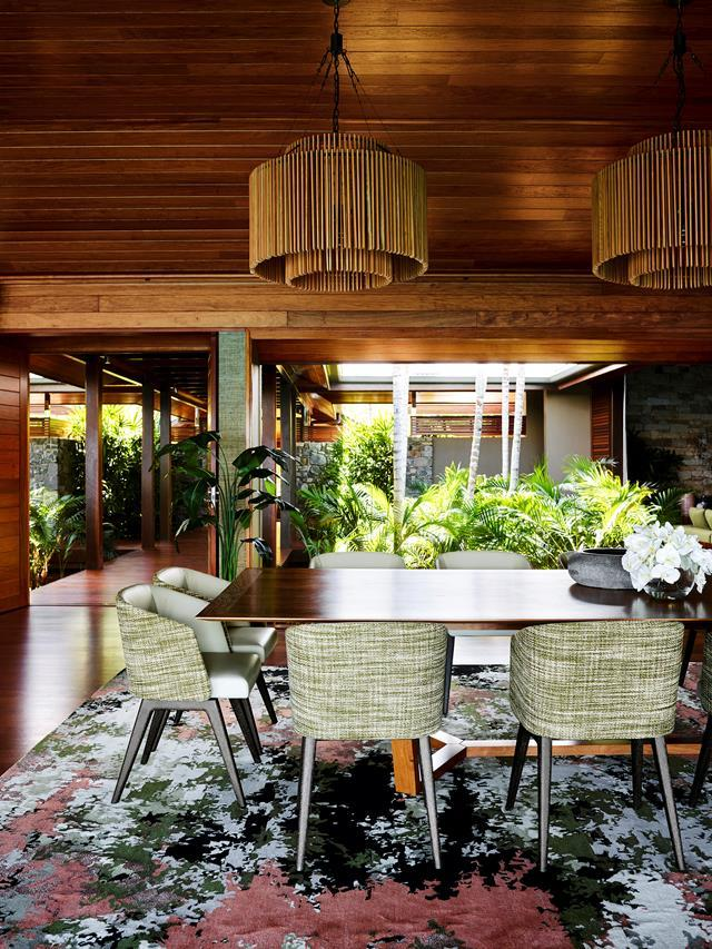 "The warm rosewood ceilings throughout were in place when Greg Natale came on board to revitalise this [Hamilton Island home](https://www.homestolove.com.au/greg-natale-hamilton-island-home-19552|target=""_blank""). ""This client loves New Guinea rosewood. It just works really well in the tropics,"" says Greg who worked the rosewood back with walnut in major pieces like the dining table."