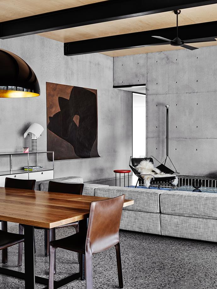 "Graphic injections of black punctuate the interior of this [modern home](https://www.homestolove.com.au/level-best-2642|target=""_blank""), visually linking spaces as well as delineating them. Accented I-beams emphasise the Russian birch plywood ceiling."