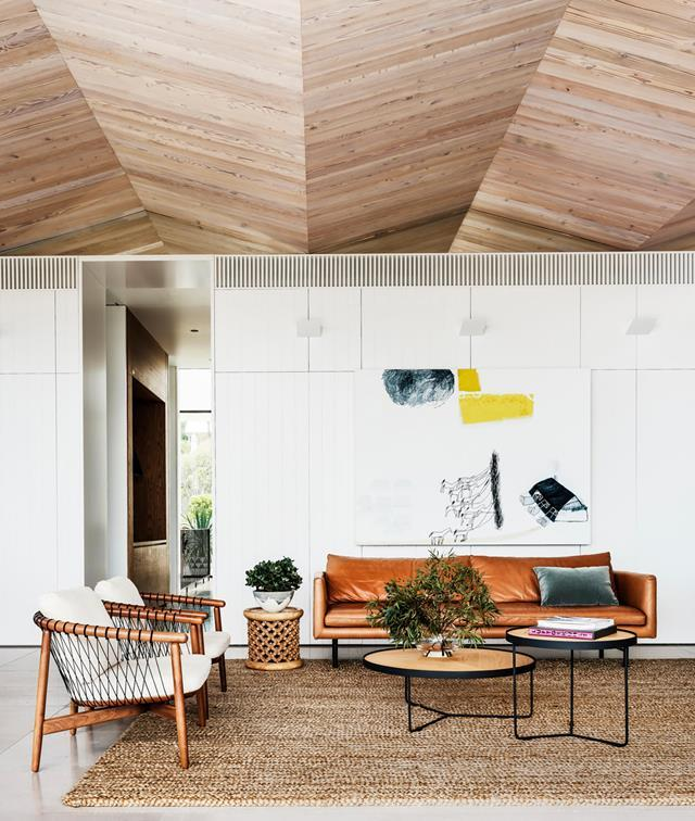"With a ceiling that traces the peaks of nearby surf and mountains, this [coastal home](https://www.homestolove.com.au/luxury-coastal-apartment-with-breathtaking-views-20736|target=""_blank"") slots right in to its laidback surrounds. The timber ceiling playfully subverts the uniformity of the pitched roofs of local dwellings."