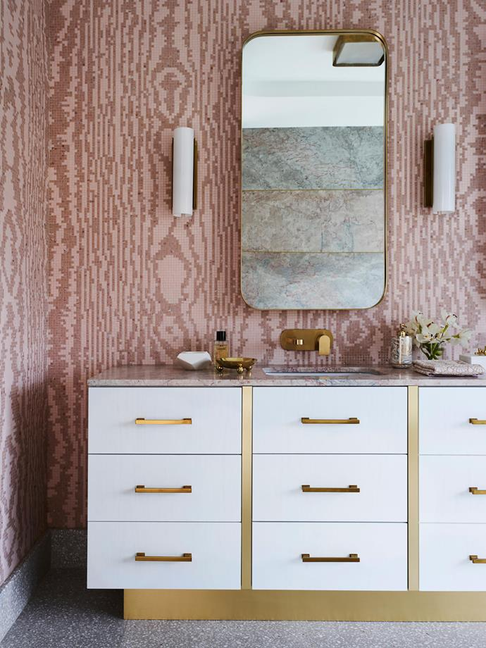 "White cylindrical wall sconces on either side of the mirror in [this bathroom](https://www.homestolove.com.au/glamorous-greg-natale-designed-bathroom-with-decorative-tiling-20650|target=""_blank"") help illuminate the vanity for all your primping and preening needs while contrasting beautifully with the statement decorative tiling."