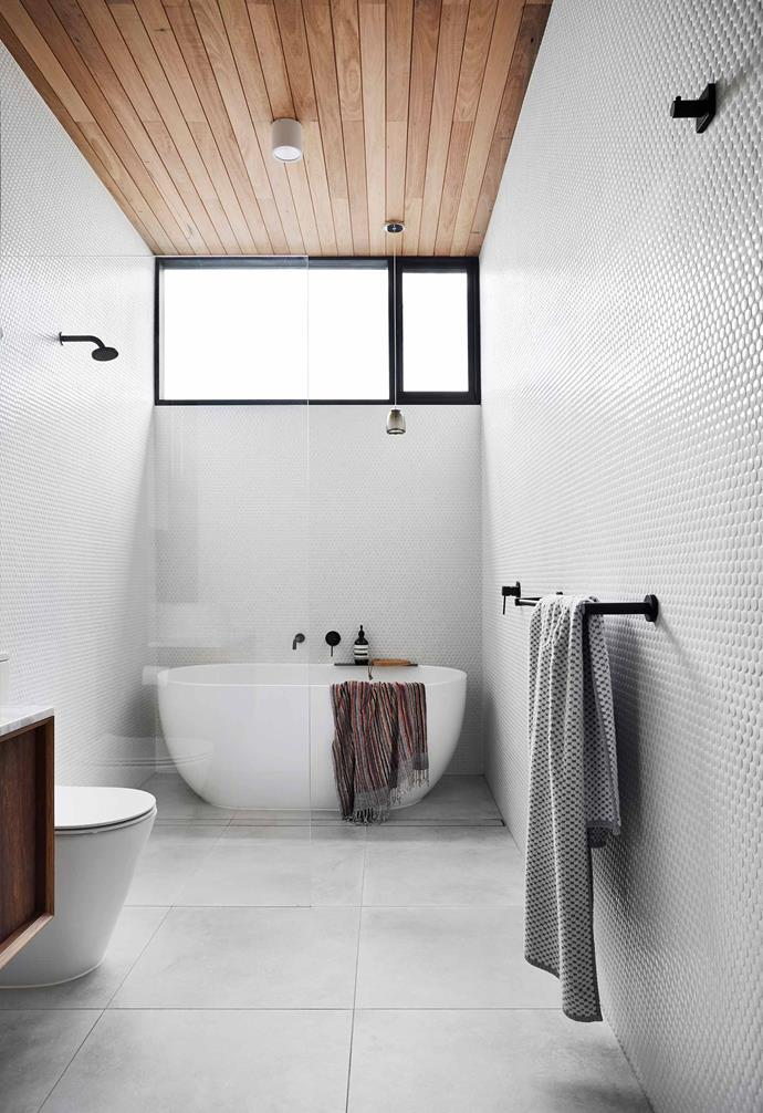 "Task lighting is of paramount importance when it comes to the bathroom from both a functional perspective, and of course, for aesthetic purposes. In the bathroom of this [renovated worker's cottage](https://www.homestolove.com.au/a-renovated-workers-cottage-that-maximises-space-19157|target=""_blank""), a small pendant light highlights the freestanding bathtub, while a cylindrical downlight helps to illuminate the rest of the space."