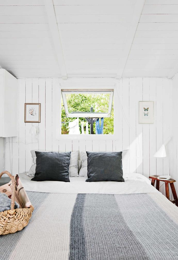 The couple now feels just as at home in Tisvilde as they do in London: Stewart can indulge his passion for cycling on the bike-friendly Danish roads and Caroline can spend time with friends and family without having to stay with them for long periods.<br><br>**Master bedroom** Striped bedlinen echoes the timber boards in the low-key yet welcoming space.