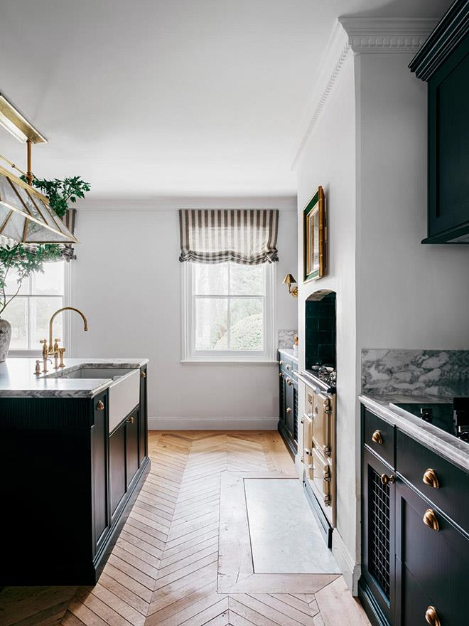 Armac Martin 'Cotswold' hardware in Burnished Brass from Gregory Croxford Living. Benchtop/splashback in Calacatta Vagli marble from CDK Stone. Walls in Porter's Paints 'Popcorn' eggshell acrylic. Recycled French oak chevron parquetry from Woodstock Resources.