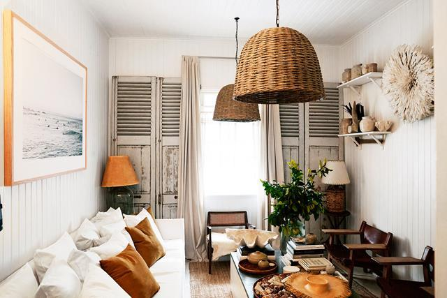 """Photographer Kara Rosenland's enchanting [workers' cottage](https://www.homestolove.com.au/kara-rosenlunds-enchanting-brisbane-workers-cottage-5590 target=""""_blank"""" rel=""""nofollow"""") is a lesson in how to squeeze a lot of style into a small footprint. She's kept her living room's original weatherboard walls and chosen a white sofa to create a sense of space in this small room. Shelving on the walls adds extra storage and a place to display all her collected treasures."""