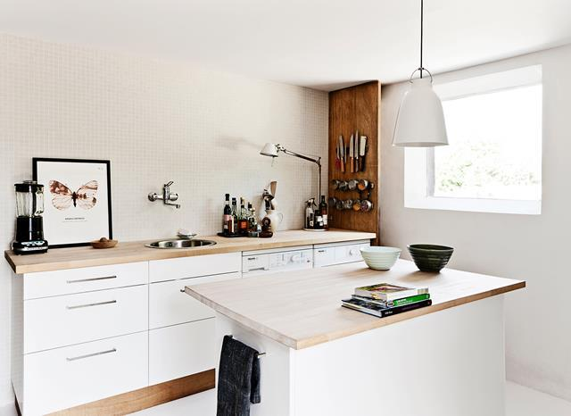 """A large barn became a stunning home and office in this [home conversion](https://www.homestolove.com.au/a-rustic-barn-renovation-4190 target=""""_blank"""" rel=""""nofollow""""), but finding space for all the room required proved a challenge. The owners cleverly utilised formerly wasted space by converting it into a two level house with a compact kitchen in a mezzanine level."""