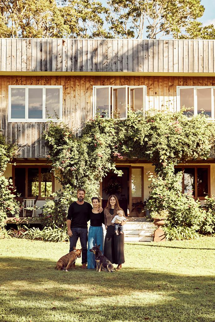 David, Jane and Hannah Fewson with baby Purslane, English bullterrier Lennie and blue heeler Bean in front of the main home.