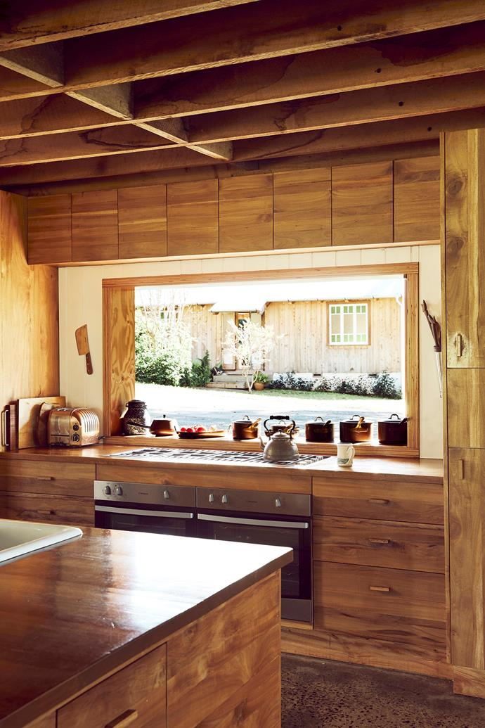 The kitchen is a medley of earthy tones.