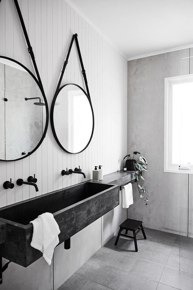 "The rustic look in the bathroom of this updated [1920s beach retreat](https://www.homestolove.com.au/updated-1920s-beach-retreat-fit-for-family-living-20989|target=""_blank"") was given a modern refresh courtesy of its black and white monochrome palette."
