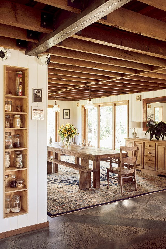 "Like many elements in this [sustainable timber home](https://www.homestolove.com.au/recycled-timber-home-sustainable-21272|target=""_blank""), this colossal dining table was upcycled and refurbished, including the addition of a new parquet-style tabletop made from many timbers. Teamed with handmade bench seating, the table can accommodate up to 30 people!"
