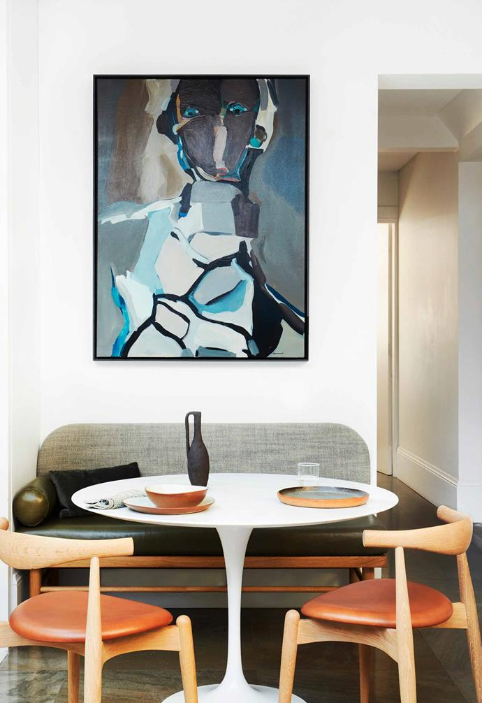 **Corner stop** A painting by Nunzio Miano from Curatorial+Co defines the dining setting. The CH20 Elbow oak chairs by Carl Hansen & Søn echo the curves of the table.