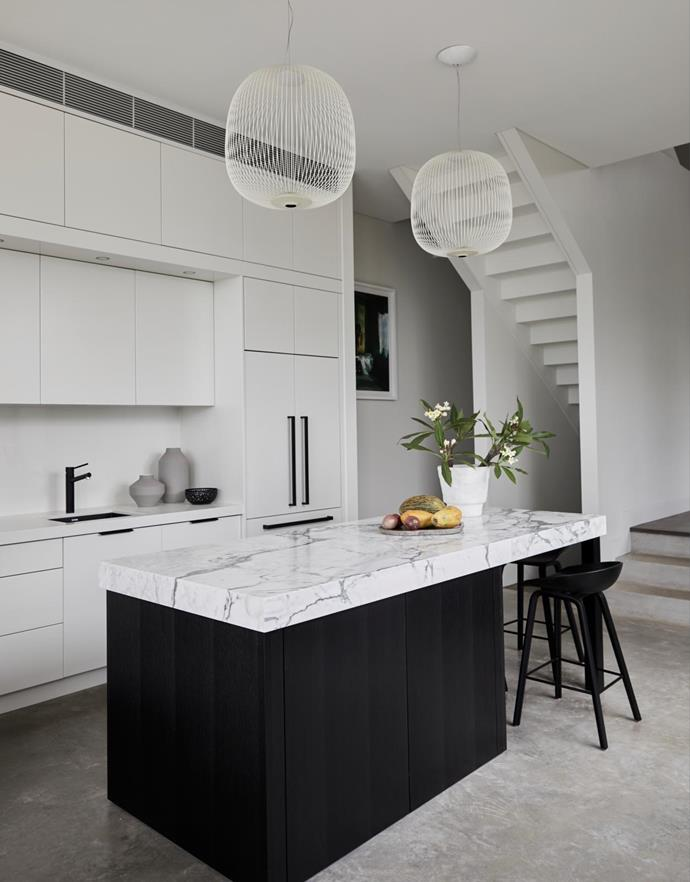 """""""We didn't want a sink on the island, we preferred to keep it clean and beautiful,"""" says Kellie. Spokes 2 pendant by Garcia Cumini for Foscarini, Space. Pepe tap and Pietra sink, both Oliveri. Miele appliances. Kitchen by Dan Kitchens."""