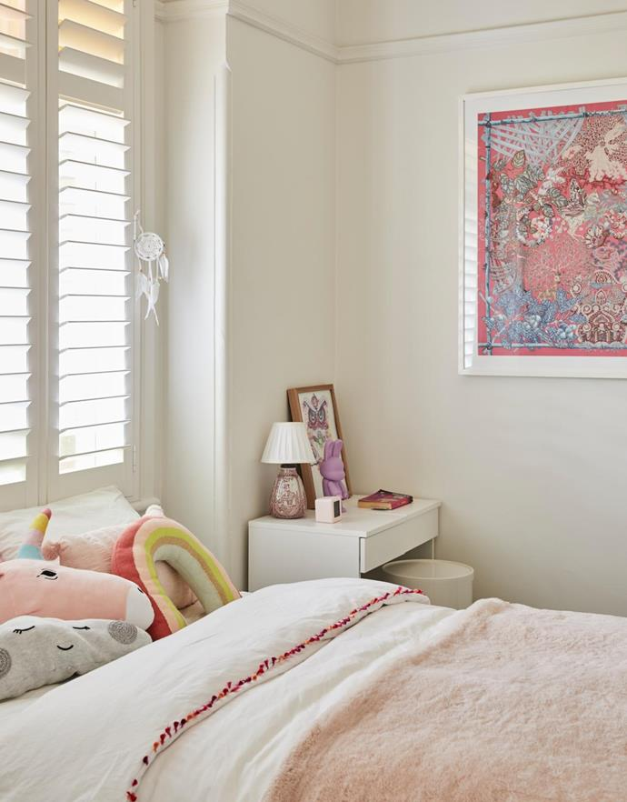 Custom joinery and soft pinks in Lola's bedroom. The artworks are framed Hermès scarves