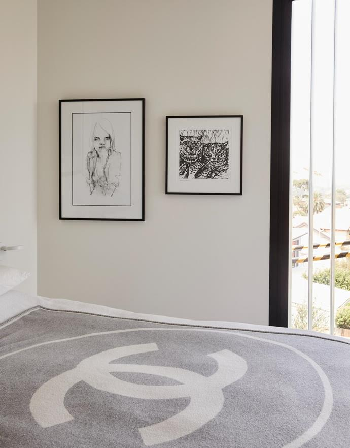 The grey Chanel blanket on Kellie and David's bed was purchased in Paris. The artwork is a Lidiko Kovacs print.