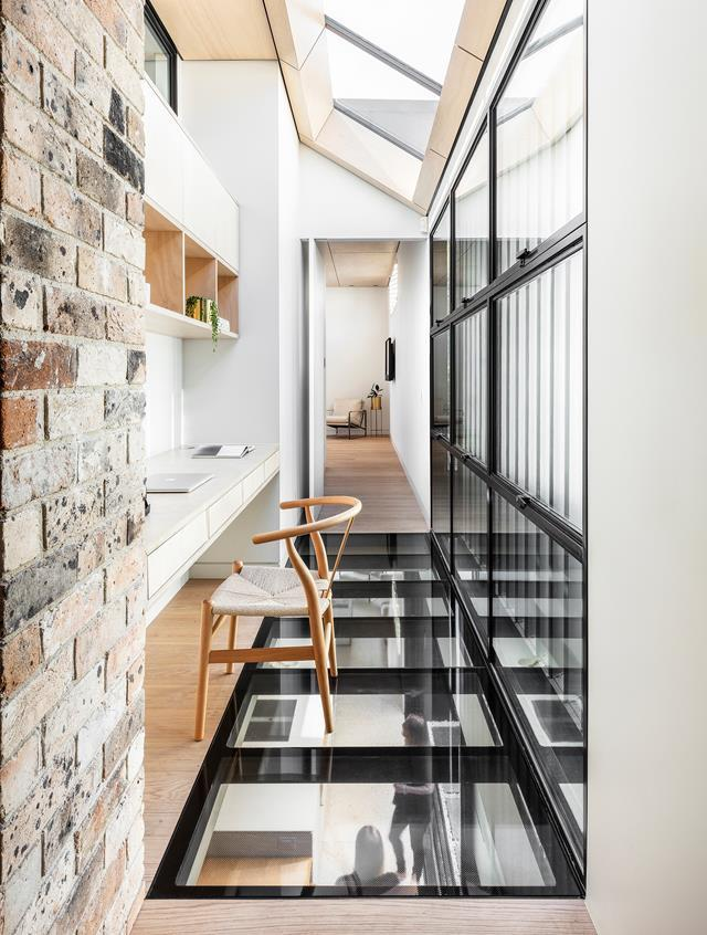 "The upstairs hallway of this [postwar bungalow](https://www.homestolove.com.au/heritage-home-receives-an-out-of-the-box-renovation-21019|target=""_blank"") turned contemporary family home accommodates a home office area. Skylights keep the otherwise closed space open and light-filled."