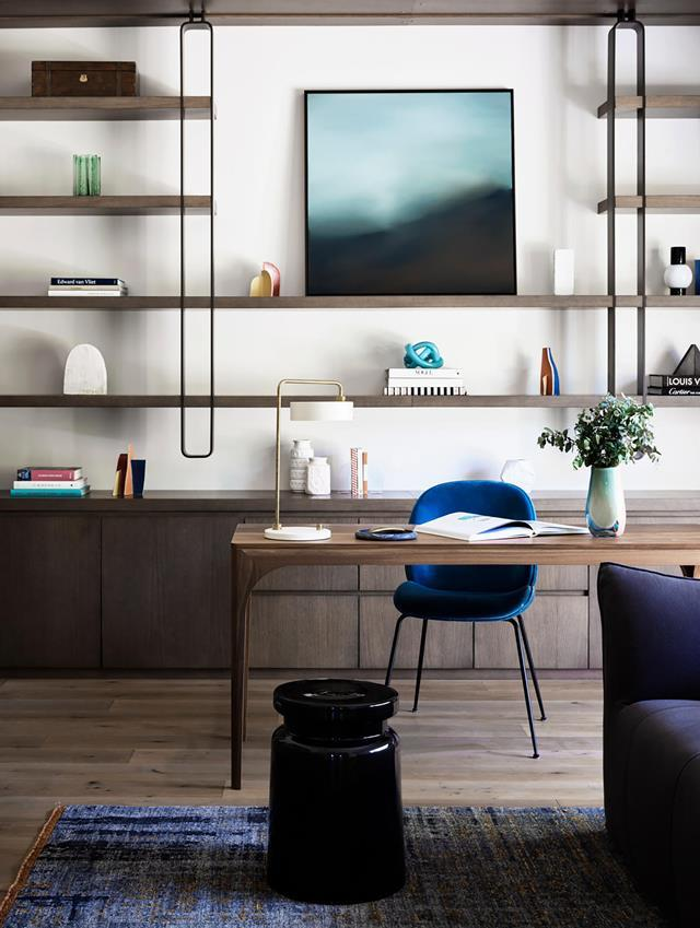 "In Sydney, a clever reworking of the floor plan and deliberately restrained furnishings have achieved a [wonderfully peaceful home](https://www.homestolove.com.au/postwar-bungalow-turned-contemporary-family-home-21021|target=""_blank"") for its busy owners. Blue hues and a natural material palette create a sense of calm in the modern office area."