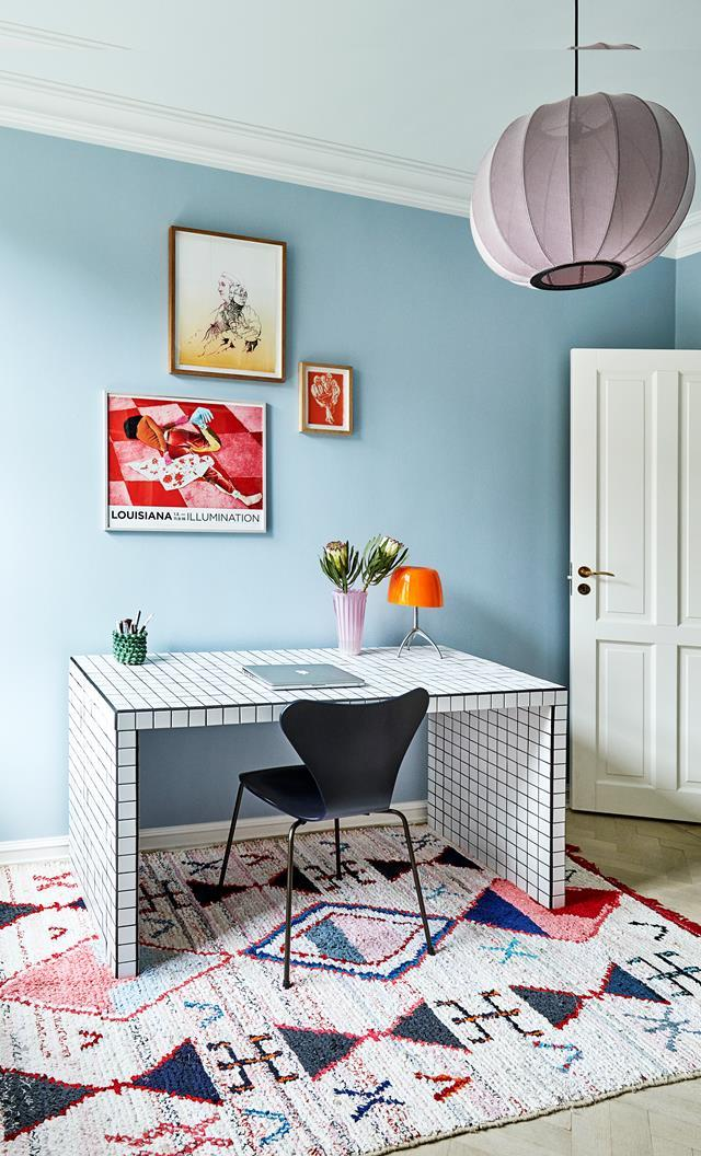 "A revised layout, colourful walls and eclectic decorating choices help reinvigorate this once tired, [old apartment](https://www.homestolove.com.au/colourful-eclectic-style-apartment-19184|target=""_blank""). The owner gave a standard Ikea ""Malm"" desk a stylish makeover by covering it with white mosaic tiles and black grout."