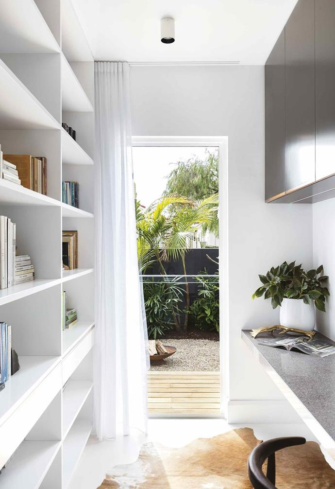 "A pair of expert renovators take on a derelict house and turn it into a [contemporary beachside home](https://www.homestolove.com.au/tropical-resort-style-home-18497|target=""_blank"") built for family fun. A clever office and library has been created downstairs that looks out over the custom- designed seating area and outdoor shower."