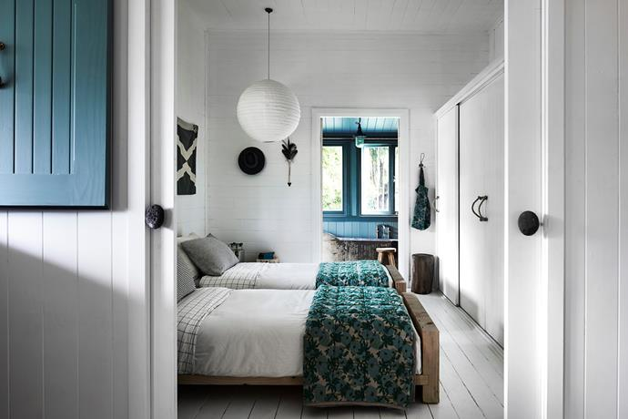 Beds dressed in linens by Society of Wanderers, wardrobe handles replaced with rope and the sliding door pulls are Stone Hooks by Normann Copenhagen.