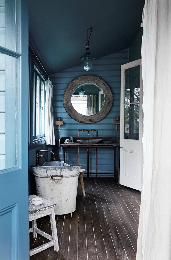 The ensuite with a zinc bathtub, old sheep shearer's bench as a vanity and stone bowl wash basin all lend a wonderfully bohemian air, in tune with my home's Byron location.