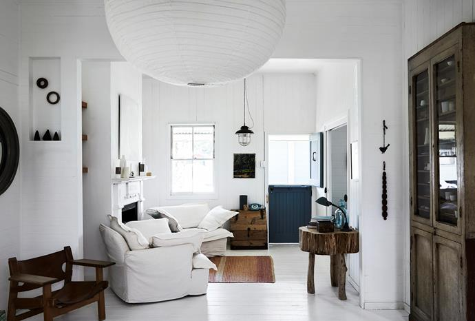 """The Spanish chair, by Danish designer Børge Mogensen, hugs a nook, while two squishy armchairs, called """"the most comfortable armchairs in the world"""" by their manufacturer Maker & Son, fill the space. The big log side table is by 'Twiggy' Greg Hatton, a favourite designer of mine. Painting by the door is a vintage find, artist unknown. The rest were hunted out with my restless eye."""