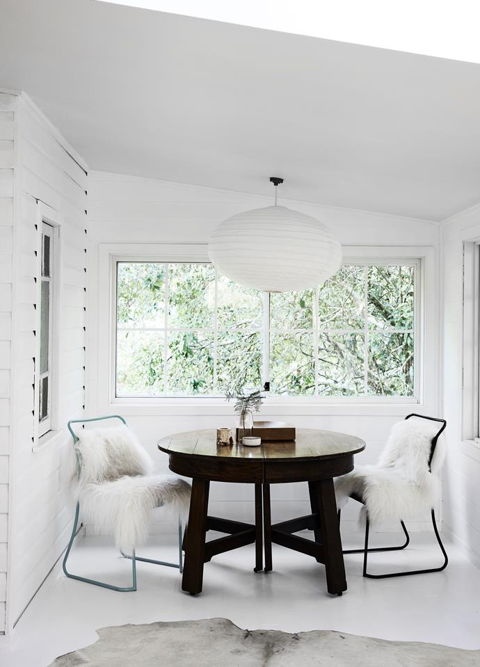 Eames dining chairs in the sunroom are made super-comfy with sheepskin throws, while an oversized cotton pendant from The Society Inc adds a wonderful luminosity after the sun goes down.