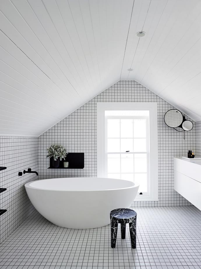 """A sculptural [freestanding bathtub](https://www.homestolove.com.au/freestanding-baths-4520