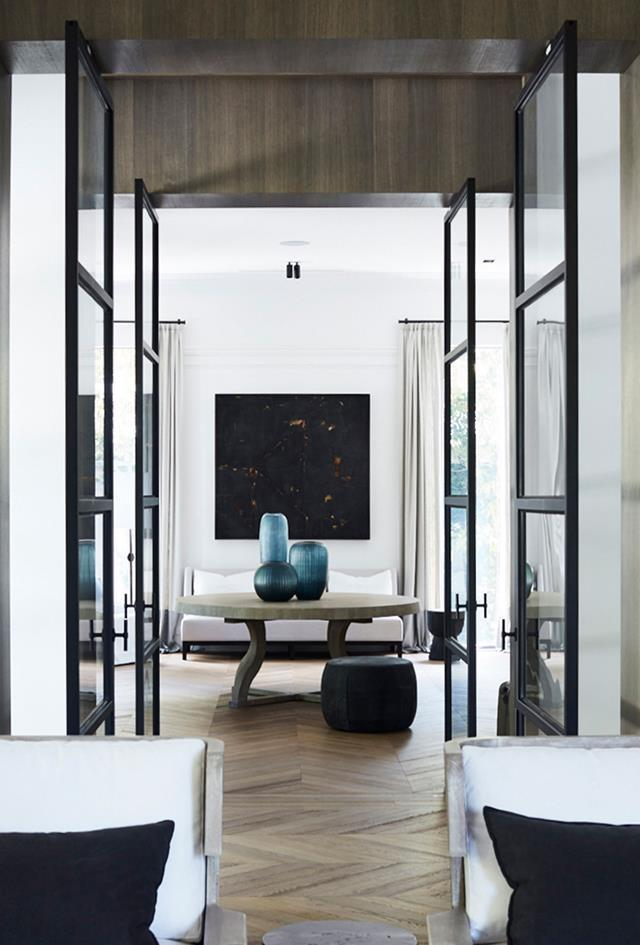 "A muted palette of alternating black and white rooms lends a pleasing rhythm to this [stylishly understated house](https://www.homestolove.com.au/melbourne-home-with-french-and-belgian-influence-6435|target=""_blank""). Dylan's brief, he says, was ""to make the house warmer and more inviting, with hand-applied dark finishes and warm timbers creating a sense of intimacy""."