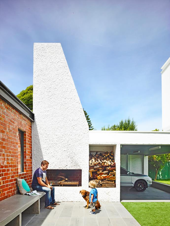 "Providing a dramatic contrast to the predominantly red-brick exterior of this [revamped Edwardian home in Melbourne](https://www.homestolove.com.au/gallery-legendary-racehorse-inspires-true-blue-renovation-1721|target=""_blank""), the outdoor fireplace features a striking stucco finish in white."