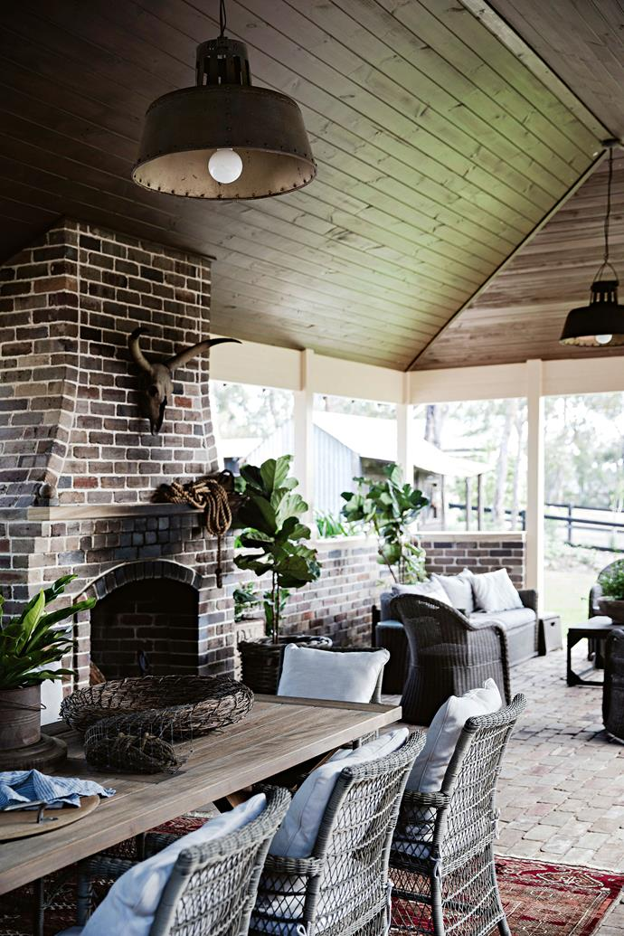 "The outdoor room of this [grand brick farmhouse](https://www.homestolove.com.au/brick-farmhouse-12079|target=""_blank"") took 12 months to create, and the end result is stunning. The brick-clad outdoor fireplace echoes the rustic country style that permeates the entire house."