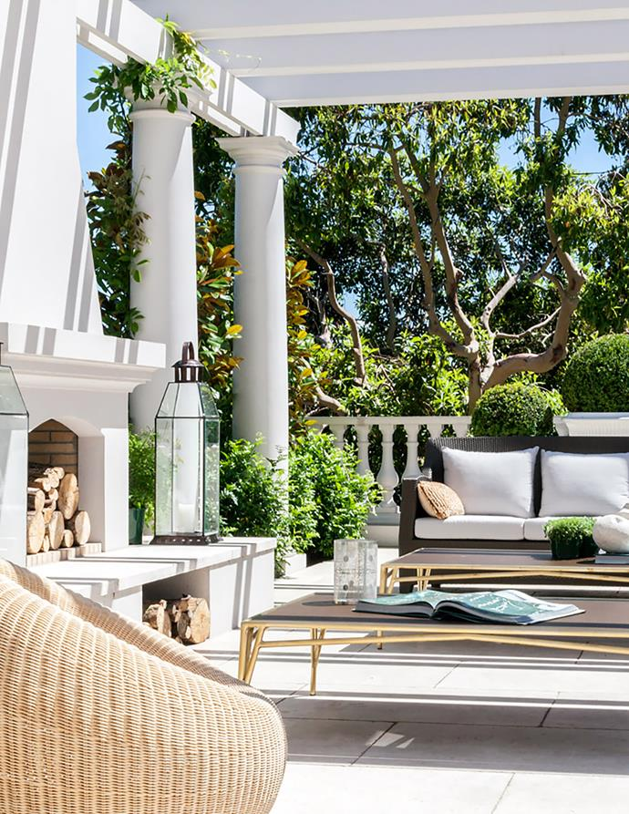 "This [grandiose home in Melbourne's Toorak](https://www.homestolove.com.au/grand-toorak-home-modelled-after-classical-french-architecture-20854|target=""_blank"") features a sculptural fireplace that complements the striking white columns that feature in the outdoor entertaining zone."