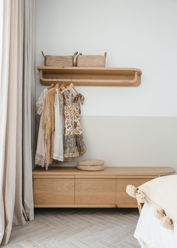 In place of a full wardrobe, Kyal and Kara have included drawers, a bench for bags and a hanging rail for clothes.
