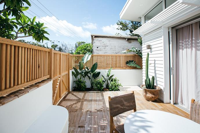 The deck has been enclosed with vertical timber panelling to make it feel like a private oasis.