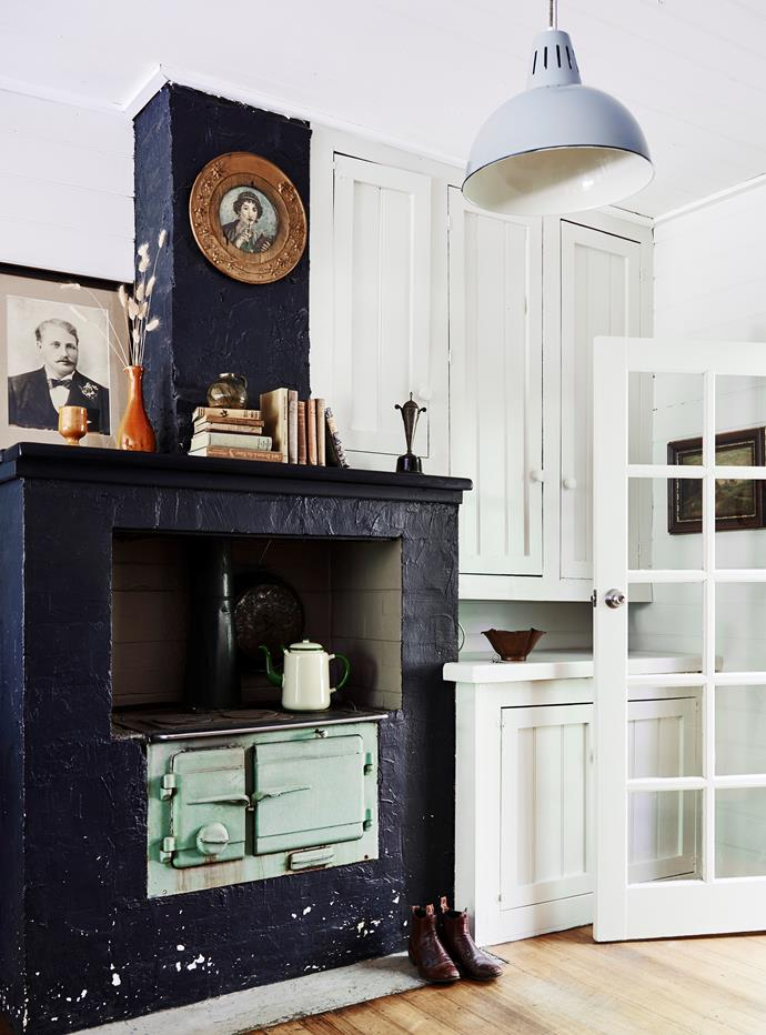 In the dining room, which used to be a kitchen, a photograph of Jennifer's great-grandfather is on the mantelpiece and, behind the door, is an artwork painted by her great-grandmother. The Grahame wood stove and oven are original to the house.