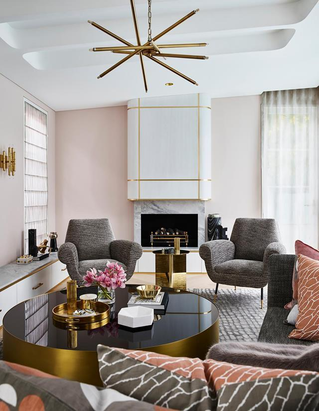 "A youthful romance with pink and grey informed the subtle palette for this [sophisticated home](https://www.homestolove.com.au/sophisticated-yet-youthful-art-deco-home-21152|target=""_blank"") which offers a welcoming embrace in its simply elegant curves. Beyond the sensuously rounded facade, the theme continues in the living area's rounded fireplace."