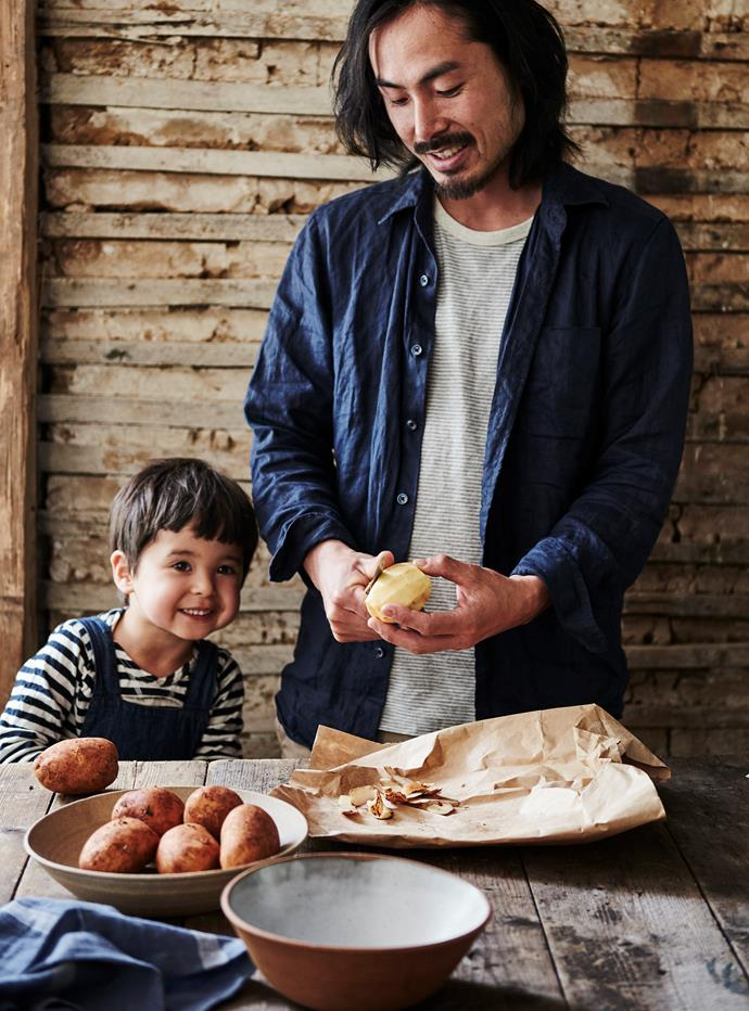 "Julia's son Haruki helping his dad Nori peel potatoes. ""I often get Haruki to do small tasks and he loves making dough,"" she says."