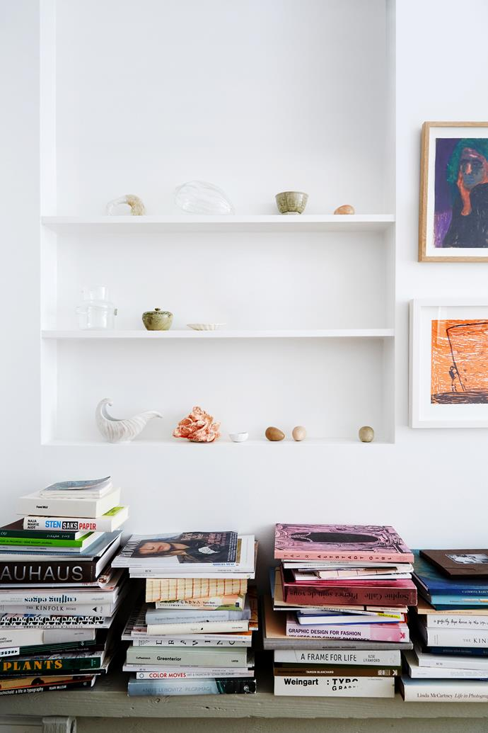 """No ledge is left bare in the living room. """"After all,"""" Cecilie says, """"it's crucial to surround yourself with the things you love most."""" A Svenskt Tenn vase and a Cathrine Raben Davidsen lamp line the windowsill. Cushions from APC and Crème de la Crème à la Edgar fill a Piet Hein Eek bucket and soften the sofa."""