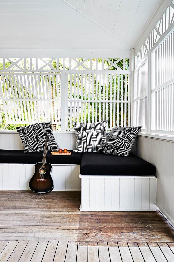 """A daybed with slatted shutters allows for both fresh air and privacy, in this [Byron Bay beach home](https://www.homestolove.com.au/gallery-kimberly-and-stephens-byron-bay-beach-house-1660
