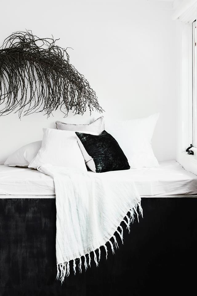 """This minimal daybed is as neat as a shelf and takes up barely any space, but it's a welcome place to put your feet up in this all-white [holiday cottage](https://www.homestolove.com.au/the-cottage-kangaroo-valley-19551