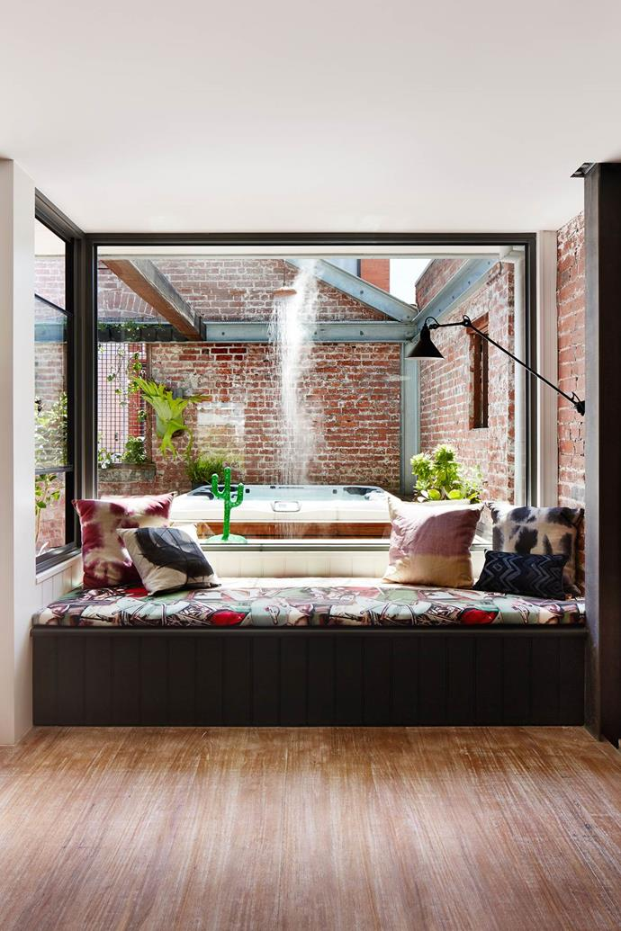 """A custom built daybed adds to the comfort of this [Melbourne warehouse conversion home](https://www.homestolove.com.au/cosying-up-a-melbourne-warehouse-conversion-3653